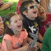 2014 Sandusky Thumb Festival - Children laughing during Gordon Russ's Magical Comedy Show.